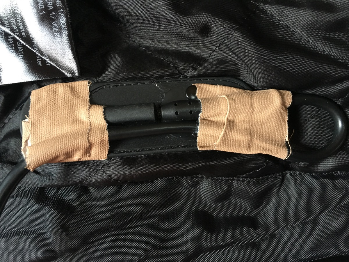 The tape holding my vest together.