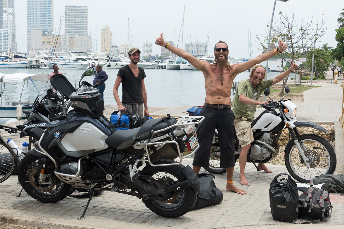 Peter, Yu Yu, and Thor celebrate. We'd finally gotten all the bikes to shore.